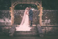Bride and Groom at Murrayshall Country House Hotel near Perth, Scotland under an arch or pergola. Perth Scotland, Country House Hotels, Pergola, Arch, Wedding Photos, Groom, Memories, Bride, Studio
