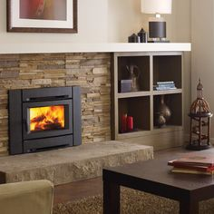 At Vaglio in Vancouver. The Alterra contemporary wood insert features a s… - Wood Burning Fireplace Inserts Home, Wood Fireplace, Wood Insert, Wood Fireplace Inserts, Brick Fireplace Makeover, Pellet Fireplace, Fireplace, Woodworking Furniture Plans, Wood Burning Fireplace Inserts
