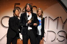 Chris Shiflett, Dave Grohl and Taylor Hawkins of Foo Fighters