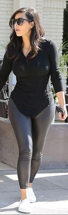 Kim Kardashian: Sunglasses – Saint Laurent  shoes – Vans