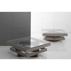 The avant-garde design of this coffee table veers away from the conventional furniture. The 4-layer glass top makes a splendid centerpiece, which is available in grey color. This Modern Coffee Table 842CT provides elegance in the living room with its unique glass layered design.