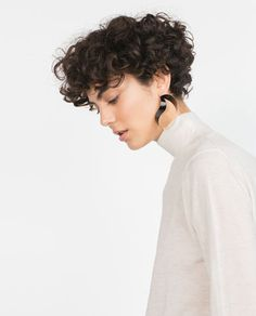 Feminine Pixie Cut with Asymmetrical Undercut - 20 Inspiring Pixie Undercut Hairstyles - The Trending Hairstyle Undercut Curly Hair, Undercut Hairstyles, Wavy Hair, Cool Hairstyles, Curly Pixie Cuts, Haircuts For Curly Hair, Short Hair Cuts, Curly Hair Styles, How To Curl Short Hair