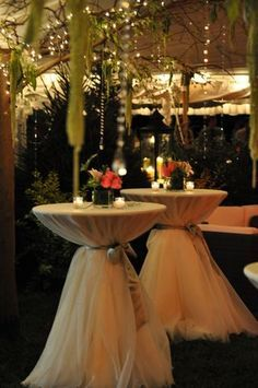 Wedding cocktail tables  with tulle: 2-3 of theses with the pool and floating candles/ flower pieces behind