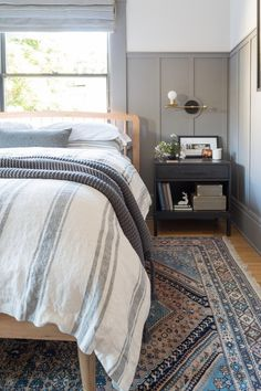 Gorgeous modern farmhouse master bedroom with grey accents. A charcoal colored … Gorgeous modern farmhouse master bedroom with grey accents. A charcoal colored night stand with a golden sconce. Striped blue and white bedding. Bedroom Black, Bedroom Green, Bedroom Wall, Bedroom Furniture, Bedroom Decor, Bed Room, Bedroom Ideas, White Furniture, Furniture Dolly