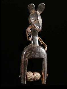 Africa | Pulley from the Guro people of the Ivory Coast | ca. 1970 | Hard wood with patina