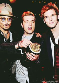 Johnny Depp, Josh Hutcherson and Sam Claflin.  What is Johnny Depp doing with Peeta and Finnick?!