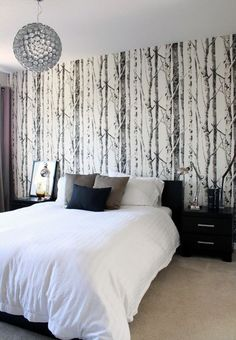 black accent wall | Contemporary black and white bedroom with a stylish accent w
