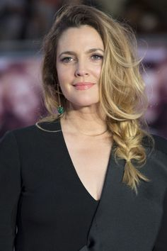 15 unique braided hairstyle ideas to try: Drew Barrymore's loose side fishtail braid.