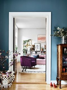 Blue wall, pink sofa and velvet armchair in the beautiful Stockholm home of Amelia Widell - photo - Andrea Papini, styling - Sasa Antic.