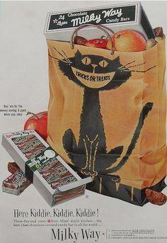 Vintage Milky Way ad with great black cat drawing on orange Halloween bag. 'Here Kiddie, Kiddie, Kiddie!'