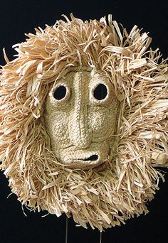 Corn Husk mask Iroquois people, Northeastern United States - There is an Iroquois society of Husk Faces or Bushy Heads. Their masks look like braided door mats on which the pile is cut off on the inside for the face, leaving a bushy fringe around the outside. Holes are cut for eyes and mouth. Husk Faces are said to be a race of agriculturalists who taught humankind hunting and agriculture.