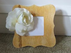 Ansel Adams. This $1 frame inspired by the beautiful rose on wood photo taken by Ansel.