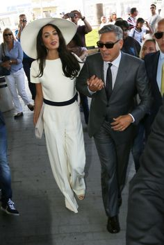 Amal Alamuddin looks elegant in an all white head-to-toe  ensemble with a white wide brimmed hat.