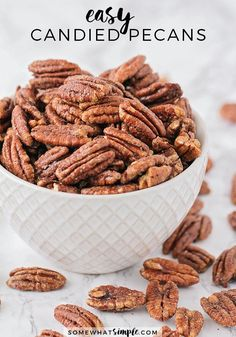 The Best Candied Pecans - Delicious and SO EASY! - Somewhat Simple   These delicious candied pecans have a sweet crunch and a touch of cinnamon. They're perfect for holiday gifts or party snacks!