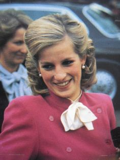 Princess Diana.  New hair-do either after Prince Harry's birth or slightly before.