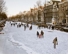 Ice skaters on the canals of Amsterdam, Netherlands