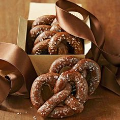 "Wrapped like a pretzel and ""salted"" with coarse sugar, this twist (see what we did there?) on the Christmas standard hits all the right notes! http://www.bhg.com/christmas/cookies/freezer-friendly-holiday-cookies/?socsrc=bhgpin121814chocolatepretzels&page=6"
