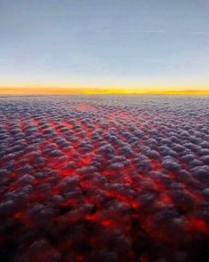 This photo was taken by Nathan Province from a at about 40 minutes from Oahu, Hawaii in July The unusual glow is from a sun angle below the horizontal plane illuminating shallow altocumulus clouds, generating a remarkable, unexpected view : pics Honolulu Hawaii, Hawaii In July, California Wildfires, Destinations, Destination Voyage, Above The Clouds, Best Photographers, Optical Illusions, Mother Nature