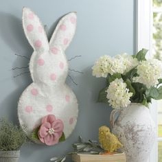 Add festive cheer to your wall decor with this Bunny Burlap Wall Hanger! The pink polka dots fit well with anyone's Easter decor.