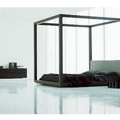 :: BEDROOMS :: beautiful Piero Lissoni Garden Bed for Porro Italy, Garden is a four-poster bed made in oak. The same eight centimetres square section defines the privacy of the night environment. The upholstered and removable headboard panel contrast the geometric rigour of the design. #bedrooms #furniture #beds