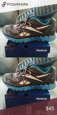 Women's Reebok Sneakers/Shoes Almost new Reebok Sneakers Women's Size 8.5 Dark Grey with Blue Accents Reebok Shoes Athletic Shoes