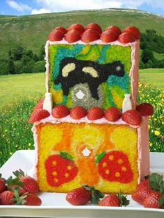 My latest cake with hidden surprises…and lots of strawberries.