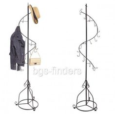 A Beautiful Free Standing Coat Rack With An Elegant Ornate Design And Classic