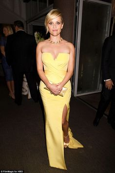 Reese Witherspoon - The beautiful star boosted her diminutive height with a pair of staggering satin heels with a dainty ankle strap that coordinated with her gown
