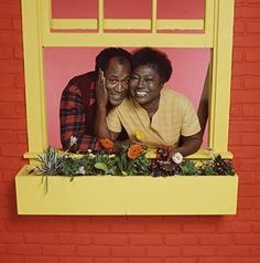 Promotional portrait of American actors John Amos and Esther Rolle as they pose behind a flowerbox on a windowframe for the television show 'Good. 90s Tv Shows, Movies And Tv Shows, Good Times Painting, Good Times Tv Show, John Amos, Black Sitcoms, Black History Month Quotes, Everything Film, Black Tv Shows
