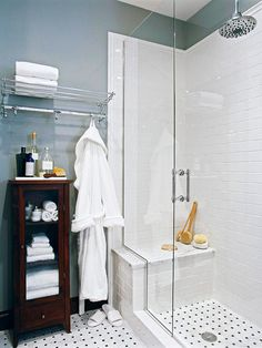 Elegant Escape  Open Design  Tall, clear-glass shower doors emphasize the small bath's high ceilings and create the illusion of more room. The white subway tile and chrome fixtures reflect light, contributing to the sense of spaciousness. Basket-weave tile covers the floor and carries into the shower for continuity.