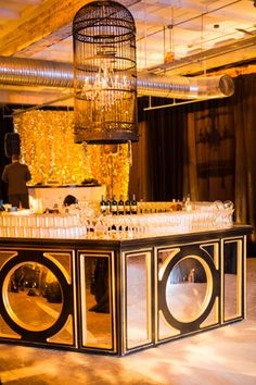 Superb Black And Gold Accents Highlighted Another Full Bar, And A Birdcage  Containing A Crystal Chandelier
