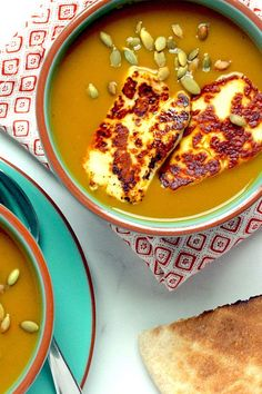 This quick and easy 15-minute curry butternut squash soup recipe incorporates curry powder, halloumi cheese and toasted pepitas to create the ultimate fall recipe meets comfort food. Whether you're looking to make this butternut squash recipe as a quick and easy weeknight dinner, fall lunch, side dish or appetizer, it's a great choice for a soup recipe. #butternutsquash #fallrecipes #butternutsquashrecipes #souprecipes #butternutsquashsoup #curryrecipes