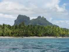 The iconic  basalt tombstone of Mount Otemanu is easy to recognize. Rising from the ocean, this half-atoll, half-mountain is surrounded by a lagoon and a series of smaller islands.
