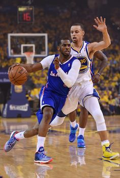OAKLAND, CA - APRIL 24: Chris Paul #3 of the Los Angeles Clippers drives past Stephen Curry #30 of the Golden State Warriors in Game Three of the Western Conference Quarterfinals during the 2014 NBA Playoffs at Oracle Arena on April 24, 2014 in Oakland, California.