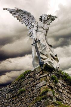 Statue of female angel holding sword (Greek goddess Nike possibly)