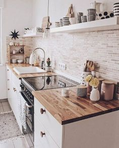 A white or black stove top cover in this quaint kitchen would add more counterspace