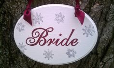 WINTER Wedding Signs SPARKLING with SNOWFLAKES Bride & Groom Wedding Chair Hangers. $37.00, via Etsy.
