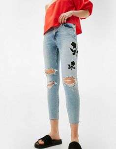 Skinny jeans with black embroidered rose. Discover this and many more items in Bershka with new products every week