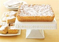 St Louis Gooey Butter Cake recipe from Serious Eats. Ingredients: cup warm milk, 1 package active dry yeast, 6 tablespoons room temperature butter, 3 tablespoons sugar, pinch of salt. Ooey Gooey Bars, Ooey Gooey Butter Cake, Butter Cakes, Gooey Cake, Yummy Treats, Delicious Desserts, Sweet Treats, Yummy Food, Homemade Desserts