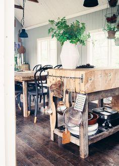Rustic kitchen with greenery and black dining chairs