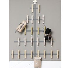 DIY advent calendar usin clothespins... clip a lil goodie bag or party favor toy to each one or even an envelope with a couple bucks! neat! I Might just do this!