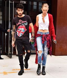 These two! #ZaynMalik held on to #GigiHadid out and about in NYC. (Photo credit: James Devaney/GC Images)