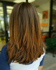 Long choppy layers in back of long brunette hair