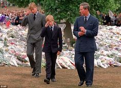 Tributes: Prince Charles accompanies his sons Prince William and Prince Harry after they arrived at Kensington Palace to view tributes left in memory of their mother Princess Diana in 1997.