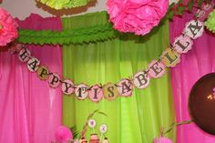 like the green and pink back drop....use extra table cloths behind present table