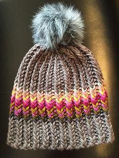 This fun, easy, quick ribbed hat busts the stash. It uses a variety of yarns held in multiple strands to get a super chunky gauge.