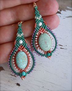 These colorful beaded drop earrings are bursting with the joy of life in lovely pastels. great if you want to add a touch of boho or tribal feel to your look. a beautiful turquoise bead is accented with cream and purple seed beads and waxed chord.  Hand woven by me, knot by knot using the ancient techniue of macrame, sometimes spelled- makrame.  In making them I use the finest quality Italian waxed cord (which does not fade tear or fray), seed beads, howlite turquoise beads goldfilled ear…