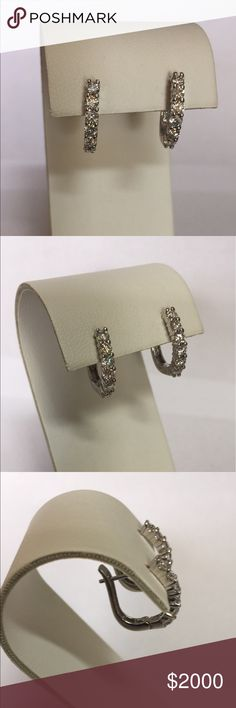 Real 14K White Gold 1.20TCW Diamond Hoop Earrings Absolutely gorgeous! Stamped 14K White Gold Diamond Earrings. Genuine, round, brilliant cut Diamonds (12) beautifully set with shared prongs. Friction lever back posts. Perfect earrings with everything.  Carat: 1.20CTW Color: H-I Clarity: SI2 Loved and worn, time to let them go. Price is firm, no trades. Posh Concierge service included. Jewelry Earrings