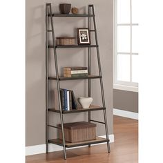 Bring a fresh new look to your home decor with this modern Elements ladder shelf. A weathered grey oak finish and a graphite grey powder coat on the metal bring subtle elegance while the five shelves offer plenty of space for decoration or storage.