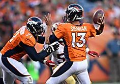 With a new quarterback, Trevor Siemian, and new faces on both sides of the ball, the Broncos held off Carolina, 21-20, in the Super Bowl rematch at Sports Authority Field. The Panthers' Graha…